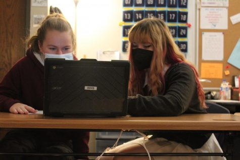 "Freshmen Molly Masalskis and Renata Olmos work on their short term project, describing where they live in American Sign Language (ASL) class. ASL is one of Olmos's favorite  classes. ""I made a lot of friends in this class and I like learning the language,"" Olmos said."