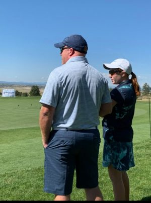 """During the Drive, Chip and Putt Regional Finals in Colorado, Jamie and Kylie Secrest overlook the course. The Regional Finals took place in fall of 2019, about a month prior to Jamie's first symptoms and about three months before he received his diagnosis. """"It was a really awesome opportunity because I got to meet so many people and got to see a part of the golf world that I wouldn't have seen otherwise. It was absolutely beautiful up there,"""" Kylie said."""