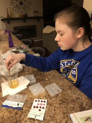 "Stirring resin, freshman Julia Thomson comes up with a new product idea. Thomson gets a lot of inspiration for Sunny Simone Co merchandise from social media. ""I'll go on TikTok or Instagram, and I will see someone have this really cool idea. It'll spark something in my mind like, 'oh, I like that color or lip gloss and that would be really cool if we did this,'"" Thomson said."
