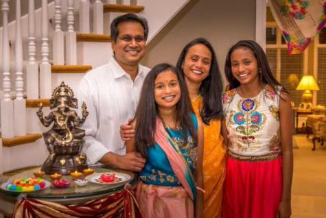 """Celebrating Diwali, the festival of lights, senior Anjali Patnana poses with her family. Patnana practices Hinduism, and Diwali is a big celebration with family. """"Diwali is so much fun, it's nice [to spend time] with family,"""" Patnana said."""