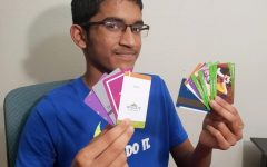 Freshman Santosh Sahoo fans out his five year hotel key card collection. Sahoo refers to them as pearls of memories stashed in his tool box.