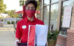 """Sophomore Tristan Caudill brings out a customer's order while working at Chick-fil-A. Caudill began his job at the beginning of the school year. """"I think working in food service, you have to deal with angry customers as well as waves of customers. Most people were nice, but you had to be prepared for those that were not. There was never time to rest. Chick-Fil-A definitely taught me how to compose myself in stressful situations and how to deal with rude or angry customers."""""""