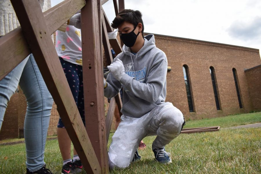 """Working with the right tools, senior Tengis Kelley participates in constructing a Sukkah for the United Hebrew Congregation. Kelley enjoyed taking part in National Honors Society and getting the time to work with his peers to help the community. """"NHS personally is a great way for someone to become better connected with their surroundings,"""" Kelly said. """"As someone who was new to the St. Louis area [as of] two years ago, working different service opportunities has helped me meet new people and learn more about the area."""""""