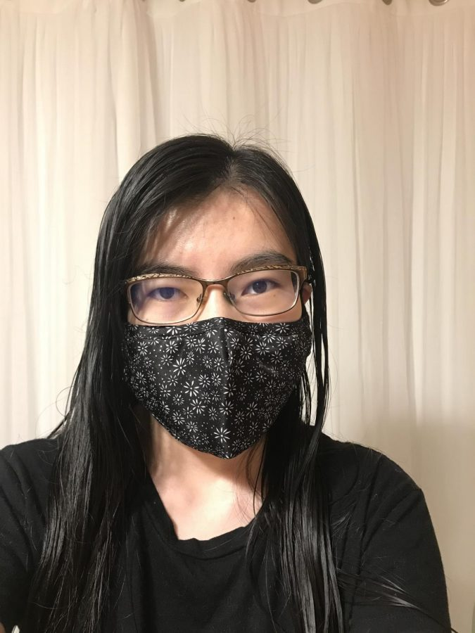Junior Jia Billadeau poses for a picture wearing her mask.