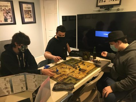 "Club members and juniors Cooper Carl,  Hector Wilkenwork and freshman Max Werner work to defeat a shield guardian in the ""Curse of Strahd"" campaign. Taken right before school went online in 2020, this was the second-to-last time the D&D club was able to play in-person. ""It"