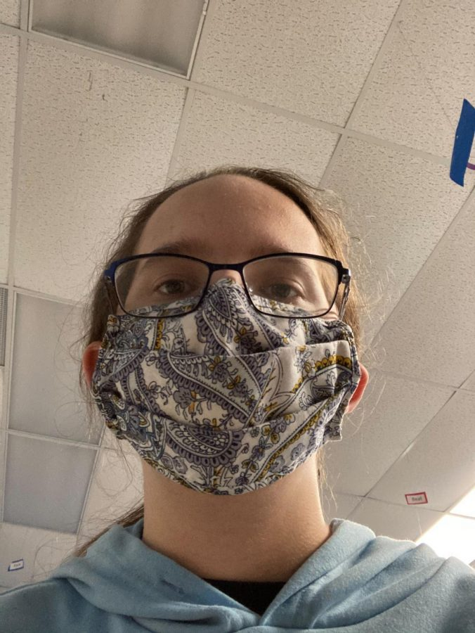 Junior Lilly Blanton poses for a picture wearing her mask.