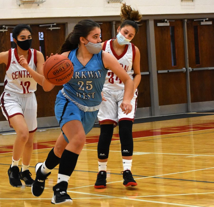 Dribbling+the+ball+down+the+court%2C+sophomore+Maddie+Humme+looks+for+an+open+teammate+to+make+a+play.+Humme+has+played+basketball+since+she+was+in+1st+grade+and+she+is+now+in+her+junior+varsity+basketball+season.+%E2%80%9CBasketball+is+my+zen.+I%27ve+always+made+time+for+it.+When+I+am+on+the+court%2C+I+am+solely+focused+on+basketball%2C%E2%80%9D+Humme+said.+%E2%80%9CI+love+being+a+part+of+a+team+and+contributing+all+I+have+to+give.%E2%80%9D