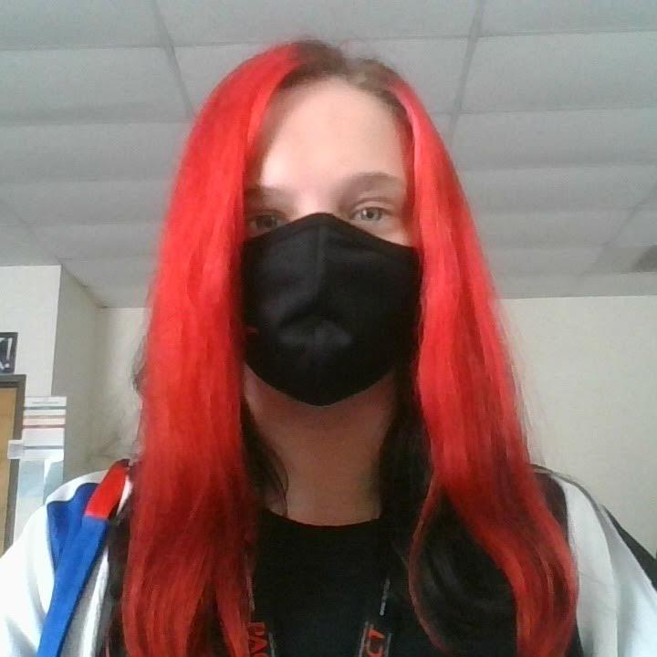Junior Jordan Ingrham poses for a picture wearing her mask.