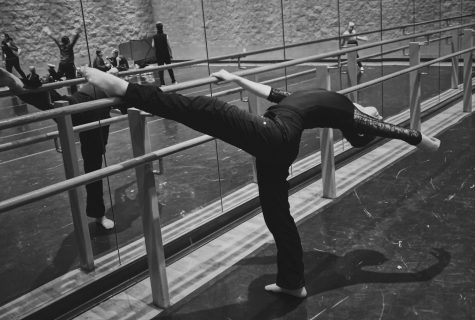 Sophomore Olivia Davis practices her flexibility, form and balance at the barre.