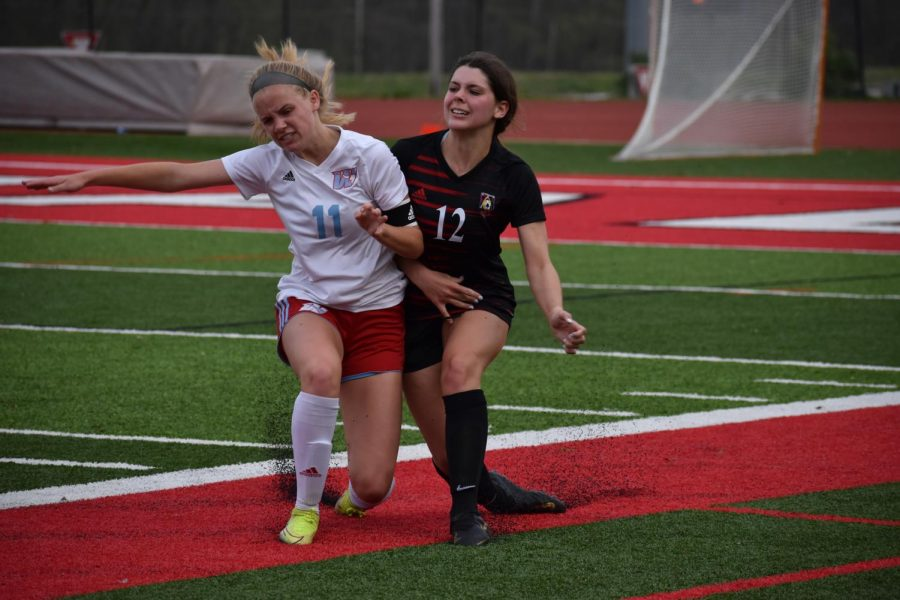 """In an attempt to steal the ball, junior Mary Hardy clashes with senior Margaux Eubank, from Parkway Central High School. The team defeated Central 6-0. """"Now we're the upperclassmen, but we haven't really had a ton of experience,"""" Hardy said. """"We didn't know a lot about the other teams as well because we didn't get to see them play last year."""""""