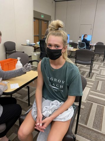 Looking at the camera, junior Megan VanValkenburgh receives the vaccine at a Mercy Clinic.