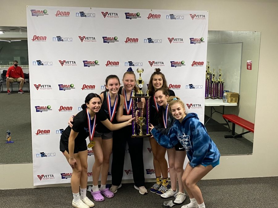 """Following a first place finish at the state tournament, the girls racquetball team celebrates their win by raising their trophy. The team participated in the JV1 bracket and hoped to move up to the varsity level next season. """"It felt good to know that we were the best team on JV1, only making us more positive we are ready for varsity next year, at least with a lot of hard work,"""" junior Graci Badami said. """"I think about all the varsity players from last year, and some of my teammates from this year, and I strive to do what they do so effortlessly. I also enjoy practicing and working to get better because it's such a fun sport."""""""