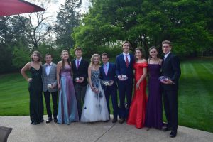 "Posing with their prom dates, senior Luke Lung and his friends celebrate planning their own prom. The group dined, danced and sung during the night. ""My favorite moment of the night probably had to have been when we did karaoke. Everyone in the group has amazing voices and we had a blast singing and just enjoying the night,"" Lung said."