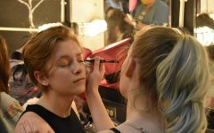 """Getting makeup put on, freshman Ashley Lewinski and senior Anya Lewinski prepare for recording the theater department's production of """"The Spell of Sleeping Beauty."""" The sisters play the red and green witches in the production which will be broadcasted to elementary schools on June 3. """"I've always loved theater. I like getting out there and acting, meeting new people. Everyone from all different communities is so welcoming. I think it's a great way to meet new people,"""" Ashley said."""