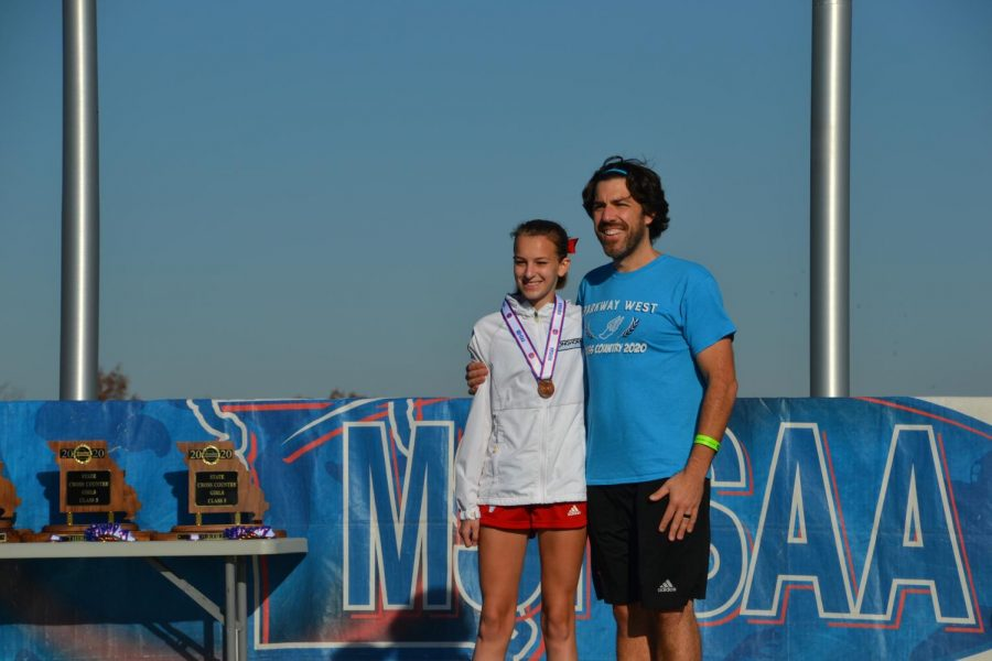 Junior Kathryn Yates poses with her cross country coach and science teacher Mr. Cutelli.