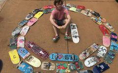 "Sitting in a circle of usable and broken skateboards, junior Ashton Beattie showcases his collection. Beattie has been skating since fourth grade and has kept every skateboard he owned. ""I sometimes will sell my boards to people and make money off of it, but right now I am also thinking about making a table and chair out of them so that they don't go to waste,"" Beattie said."