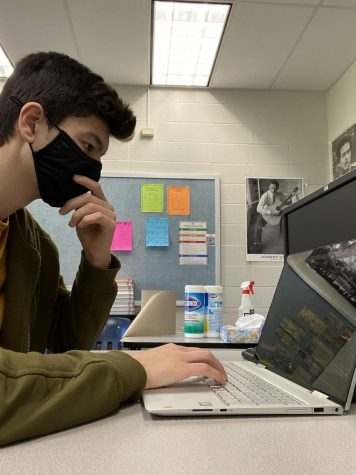 Senior Tengis Kelly works on coding a project while cadet teaching.