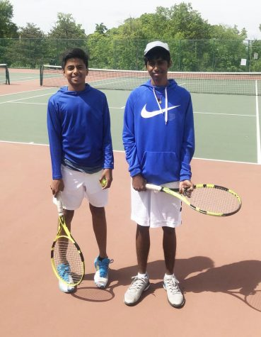 """Freshman Raj Jaladi and senior Sri Jaladi pose for a photo after tennis practice. The brothers and teammates had high hopes to play in state but ended their season losing to Priory's doubles team in the second round of districts. """"It's not like we don't get along at home, but we communicate best at a tennis match,"""" Raj said."""