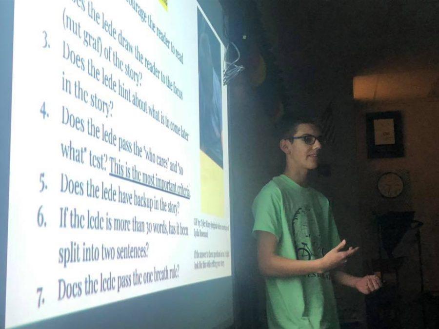 Senior Tyler Kinzy teaches 2019-2020 Convergence Journalism I students how to write ledes.
