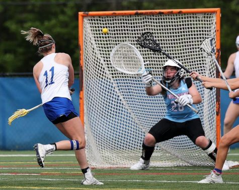 """Freshman and goalie Rachel Livak reaches out to save the ball from going in the net and prevents  a point for Ladue. Livak made the varsity team and has led the St. Louis area in saves with 213. """"The most memorable part of my season was when they were telling us what teams were going to be on, I honestly kind of knew when I was told to go talk to Lovercheck and Herpel, but it was still an amazing feeling to know that I did it,"""" Livak said."""