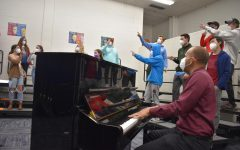Coaching through rehearsal with the Jazz Choir, Parrish looks at what he has created. Jazz choir is one of many choirs Parrish directs and choreographs here at West.