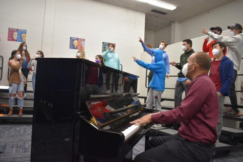 """Coaching through rehearsal with the Jazz Choir, Parrish looks at what he has created. Jazz choir is one of many choirs Parrish directs and choreographs here at West. """"Teaching music is still a rush every time I do it. I never count the minutes, I am never bored,"""" Parrish said."""