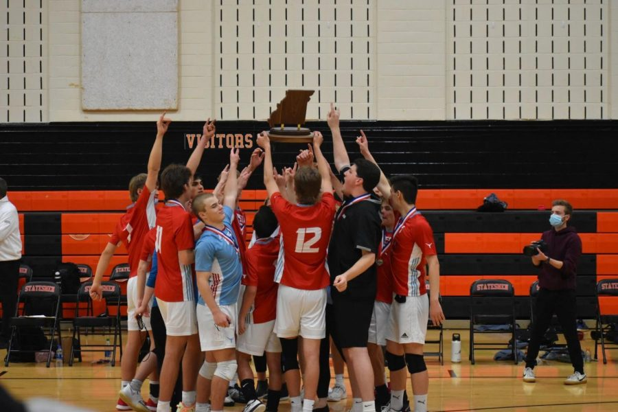 """After scoring the winning point, senior Matt Cosgrove holds the State Champions plaque above his teammates. Seconds later the crowds stormed the court in celebration. """"It was just unreal. I was speechless to finally win after talking about it for more than a year.  Unreal feeling,"""" Cosgrove said. (Photo courtesy of Matt Cosgrove)"""