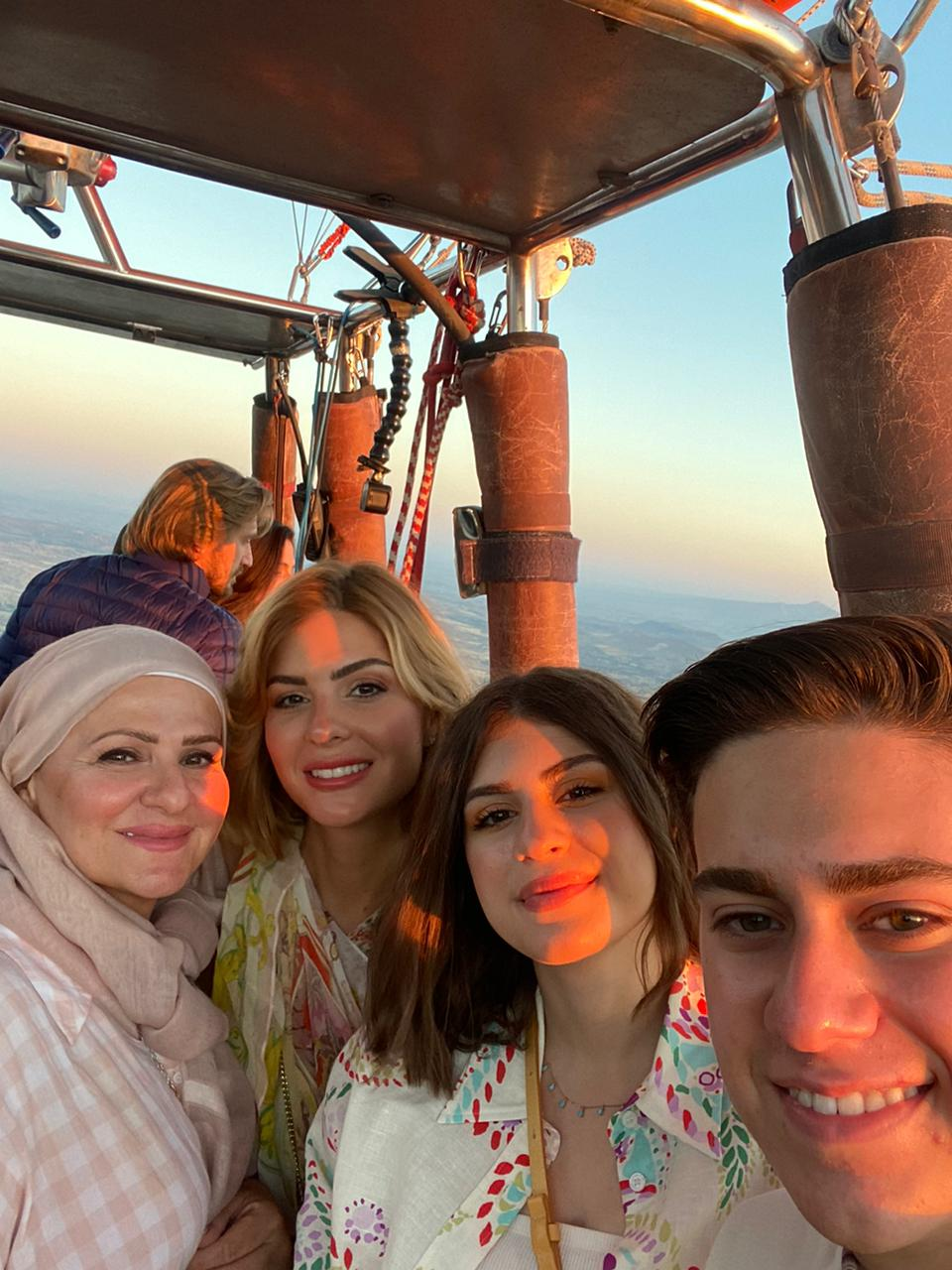 """Ahmad and Joudi take a quick photo with their mother and older sister, Leena, during the hot air balloon ride. Leena lives in Dubai where she works as an Instagram influencer, and this was their first time seeing her in almost three years. """"I was shocked to see her because I hadn't seen her in so long. When we saw each other, we both kind of ran towards one another,"""" Joudi said. """"She was in Cappadocia for the [music] festival because [a brand] reached out and invited her so that she can post about it."""""""