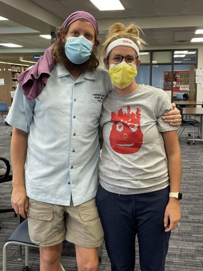 """Librarians Brian Welch and Lauren Reusch dressed up as Chuck Noland and Wilson the volleyball from the movie """"Cast Away."""" Welch's favorite part of spirit week was getting to see the marching band play through the halls Friday morning. """"It was fun to see the freshman's reactions to the band because it was their first homecoming and some of them looked really surprised,"""" Welch said."""