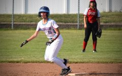 Taking her lead off of second base, freshman catcher Ansley Forbes prepates to make a run to third. The JV softball team beat Fox 7-3 in their game on Sept. 10.