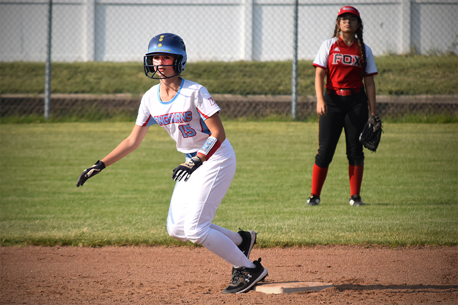 Taking+her+lead+off+of+second+base%2C+freshman+catcher+Ansley+Forbes+prepates+to+make+a+run+to+third.+The+JV+softball+team+beat+Fox+7-3+in+their+game+on+Sept.+10.+%22I+think+%5Bwe+won%5D+because+we+had+great+communication+and+offensive+work+during+the+game%2C%22+Forbes+said.+%22We+all+work+hard+and+are+supportive+of+each+other.+I+am+looking+forward+to+the+competition+for+this+season+and+improving+as+a+team.%22