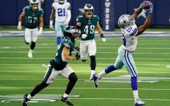 Dallas Cowboys wide receiver Amari Cooper (19) hauls in a long pass against Philadelphia Eagles safety Marcus Epps (22) during the first quarter of an NFL football game at AT&T Stadium on Sunday, Dec. 27, 2020, in Arlington.