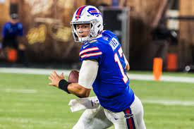 Buffalo Bills quarterback Josh Allen rolls out of the pocket to make a pass against the Cleveland Browns. by Attribution 2.0 Generic. Photo used under Creative Commons Licenses.