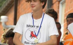 """Freshman Brenden Porter relaxes after competing in the Stan Nelson Invitational Saturday, Sept. 11. """"I was proud of myself for doing a good job. Also, [I have] respect for all the other [runners], because it's definitely not an easy thing to do,"""" Porter said."""
