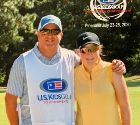 """Overlooking the iconic Pinehurst golf course, Kylie and Jamie Secrest pose for a picture in the fairway of the 2020 World Teen Championship. This tournament was strictly invite-only and Kylie excelled, achieving 37th in her age group, her dad right by her side. """"This was one of the last times my dad was able to caddie for me before he was unable to do so due to his ALS,"""" Kylie said. """"I loved him caddying for me. He always knew what to say [to me] when I got upset and he was able to see me grow throughout my golf career."""""""