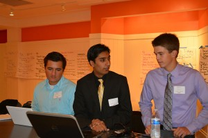 Jack Koury, Saad Sukhura, and Brett Darland all prepare for their pitches.
