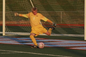 """Andrew Engelmeyer kicks the ball away during the game against Ladue. """"The Ladue game was a really good game, one of the two best moments of the season."""""""