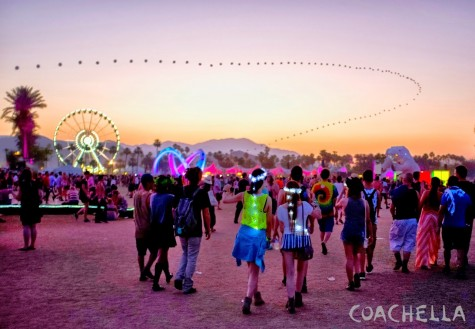 Spectators watch the sky at Coachella Music Festival.