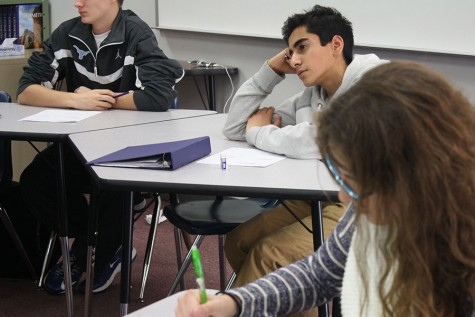 Hussain Yasin listens to a lecture in his Geometry Class.
