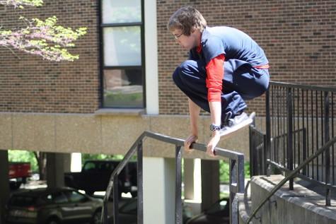Freshman Joe Butler hurdles over a rail while practicing his parkour stunts.