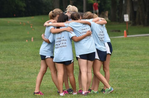 Girls XC gets out the broom