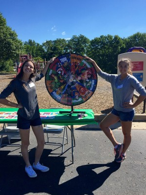 Seniors Grace Gwin and Kaitlyn Kastberg help set up games and help run them at the Green Trails Carnival on September 19th for Community Outreach at West hours.