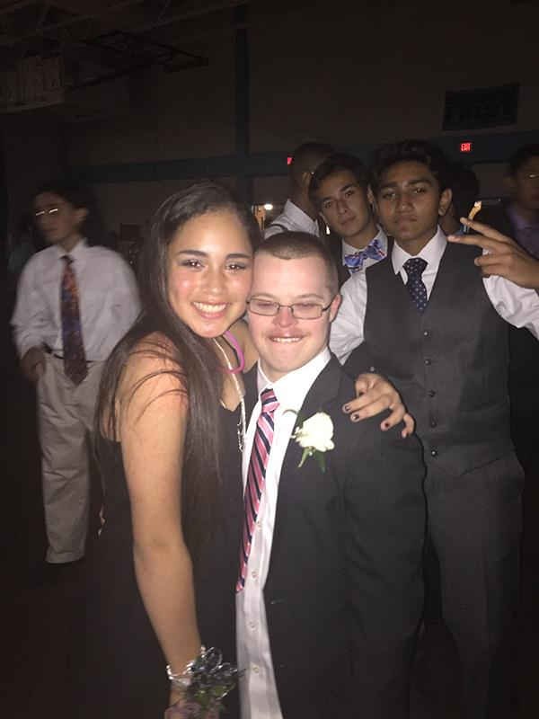 Freshman Miqueyla Lopez smiles with sophomore Luke Whitten after dancing together at Homecoming.