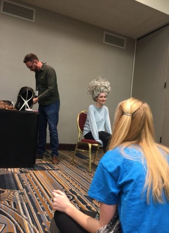 Sophomore Kennedy Brown tries on the Ursula wig in a workshop at Thescon.