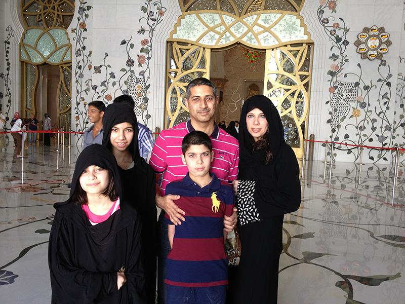 Sophomore Dana Alshekhlee (second to the left) poses with her family inside the sheik zayed mosque in the city of Abu Dhabi, located the United Arab Emirates.