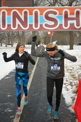 Osborne and Butler cross the finish line of the Frostbite Half Marathon