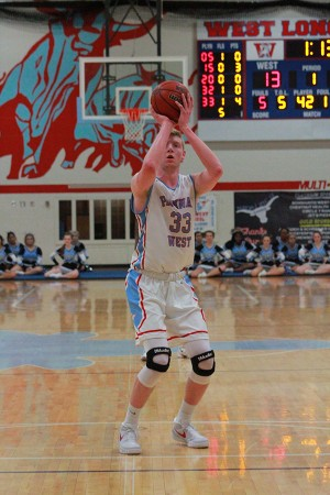 Junior Wyatt Yess spots up at the free throw line after drawing a foul.