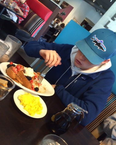 Emma's brother Ben Ratliff enjoys french toast with fresh mixed fruits.