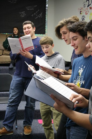Jazz Choir students senior Omar Deiab, junior Alex Dunn, and seniors Jacob Cupps, Connor Gately and Alex Hubbard prepare for the upcoming Coffee House.