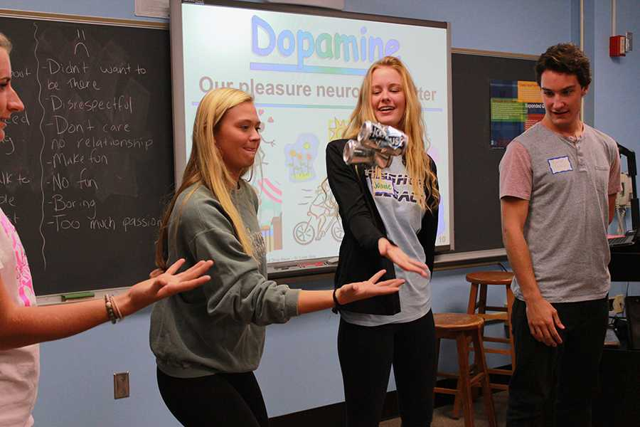 Disclaimer: Students pictured above are not quoted in the article. Seniors Grace Miller, Claire Dreller, Jamie Gardner and Connor Gately toss a can to each other during a TryPod field trip.